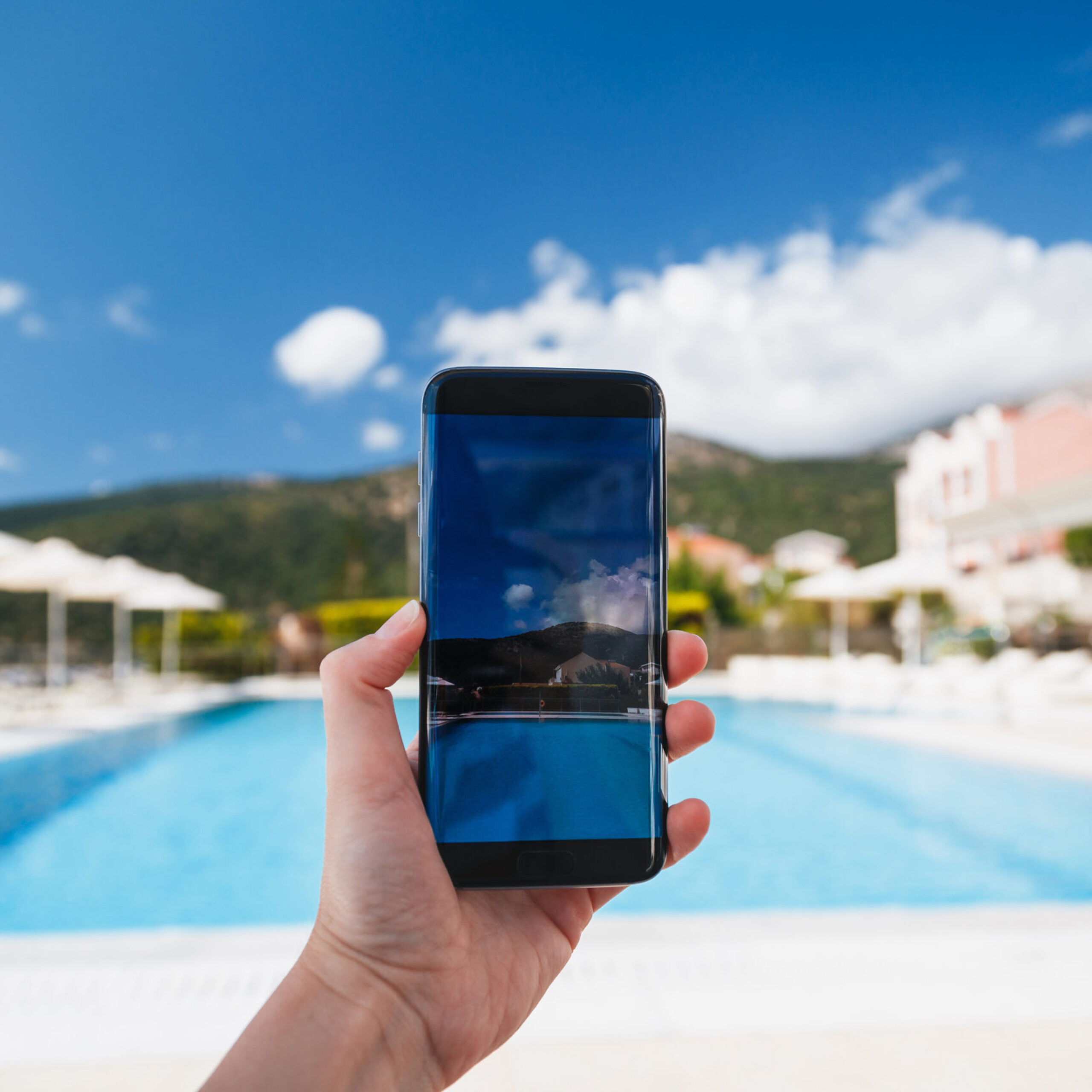 Young Woman Makes Photo Of Swimming Pool Area, Blue Sky And Beau